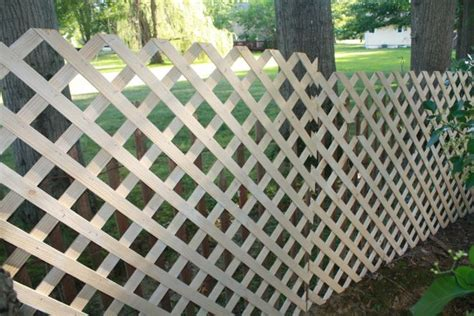 Temporary Backyard Fence by Repurpose Lattice Make A Temporary Fence In Your Yard We