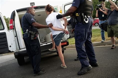 woman arrested handcuffed 100 arrested in walmart protests union says al jazeera