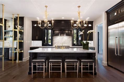 Black Kitchen Island Lighting Gold And Black Kitchen With Thick White Marble Countertops Contemporary Kitchen