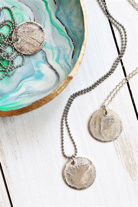 make fingerprint jewelry to do this use metal clay at home to make a