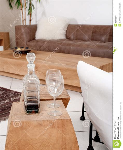 couch glasses chagne glasses with modern couch in background royalty
