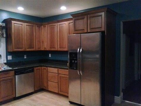 painting cherry cabinets white my kitchen remodel dark granite cherry cabinets teal