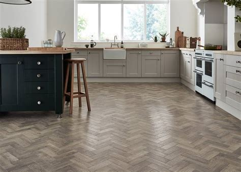 Herringbone style floors. Wood, LVT, Carpet and Rugs