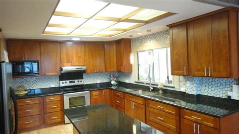 light cherry c c cabinets and granite