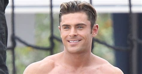 shirtless zac efron looks super buff filming a scene for