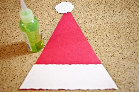 How To Make Santa Hats Out Of Paper - how to make a santa hat out of paper with pictures ehow