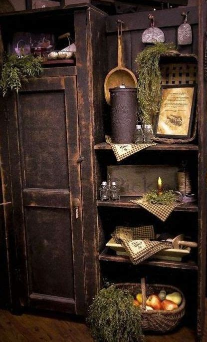 how to decorate shelves with primitives armoire shelf