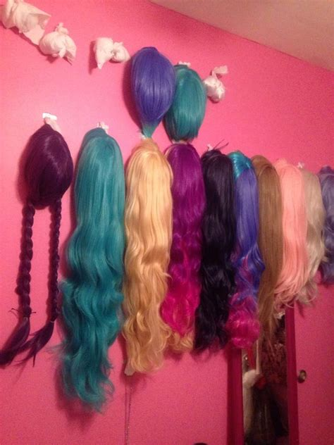 your own hanging l your own wig wall l email wigs