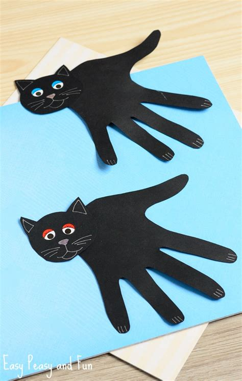 Easy Halloween Arts And Crafts For Kids - handprint black cat craft easy peasy and fun