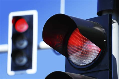 failure to stop at light blinking light and right of way auto accidents
