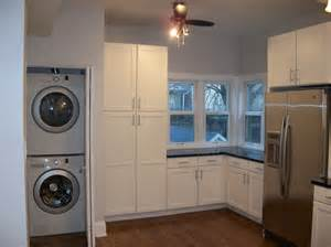 stackable washer dryer laundry room traditional with built
