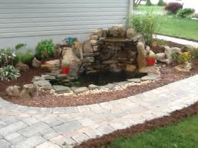 small pond and waterfall water features