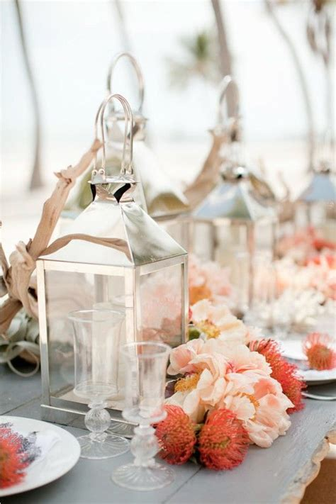coral wedding tables silver lantern centerpieces and