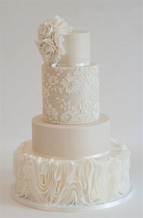 white wedding cake white textured beige wedding cake white lace wedding