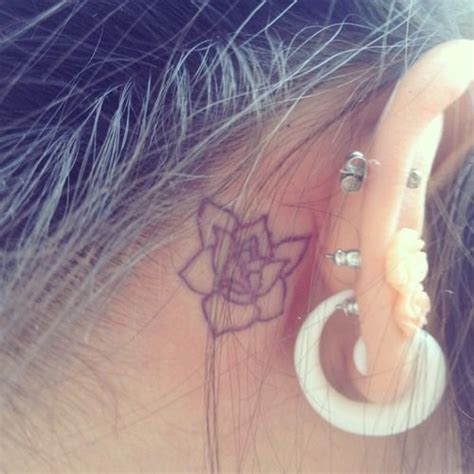 flower tattoo behind ear behind ear tattoo a magnolia there would be pretty cute