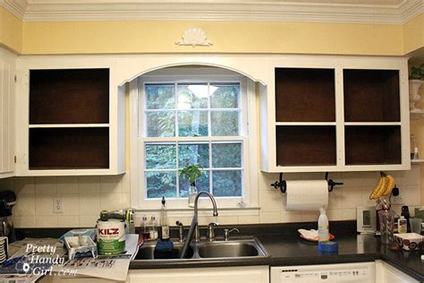 Do You Paint The Inside Of Kitchen Cabinets Fabric Backed Open Kitchen Cabinets Diy On A Dime The Tutorial Pretty Handy