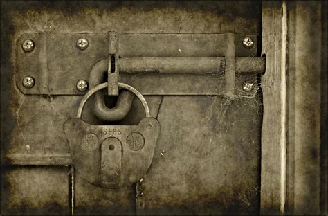 vintage grungy lock on a door photo www