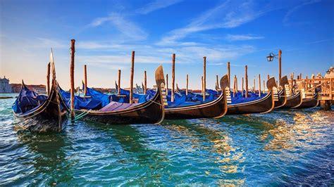 boat hotel definition venice sea with turquoise colored beautiful boats gondola