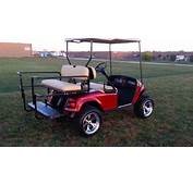 Lifted Candy Apple Red Metallic EZGO Golf Cart With Turn