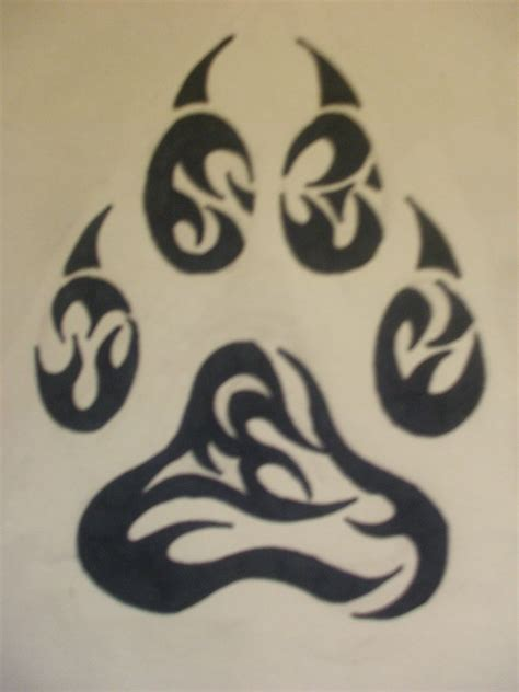 wolf paw tattoo designs tribal wolf paw by amitrixwolf on deviantart