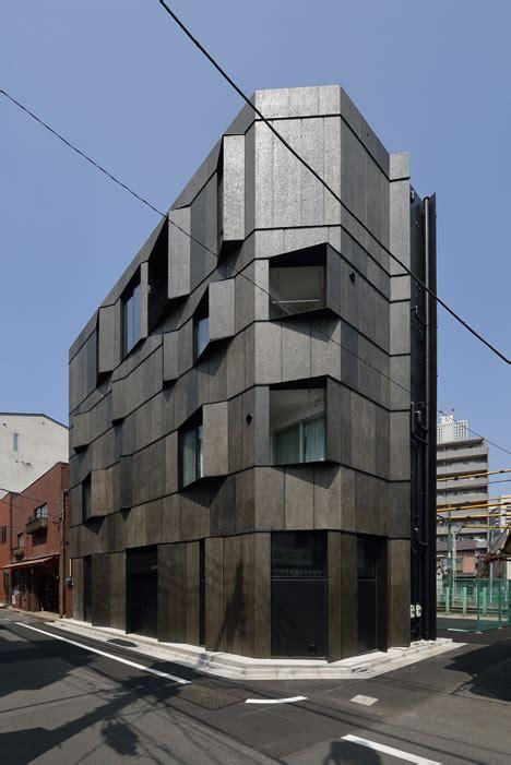 angled fins flank  windows  kino architects tokyo