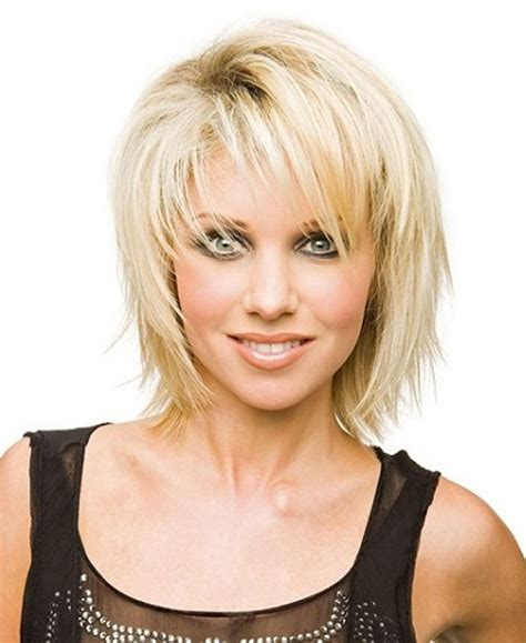 layered choppy mid length hairstyles for women with oblong faces over 50 medium length choppy hairstyles with bangs mid length