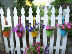 creative diy hanging flower planter pot holders on a fence painted with white color ideas