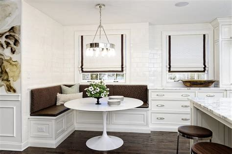White and brown dining space with built in banquette transitional kitchen