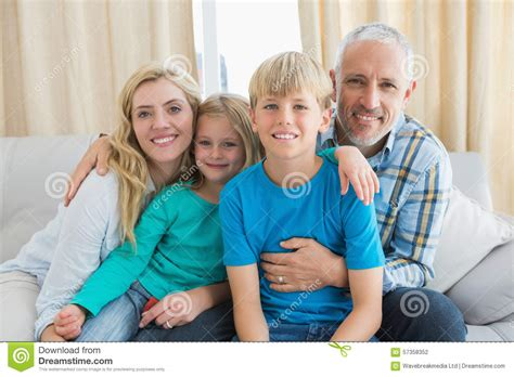 couch family happy family sitting on couch together stock photo image