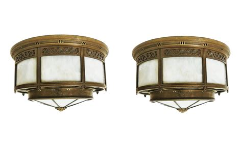 a pair of classic american deco bronze ceiling lights