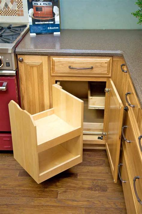 blind corner kitchen cabinet solutions the blind corner cabinet above makes better use of corner space and stores more goods than