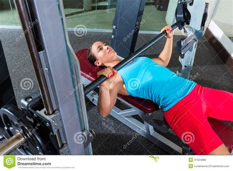 girls bench pressing bench press girl flat multipower smith machine stock photo