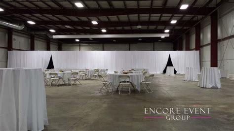black velour white draping warehouse grand opening