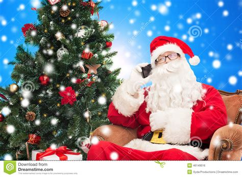 img of santa claus and x mas tree santa claus with smartphone and tree stock photo image of application gadget 46149516