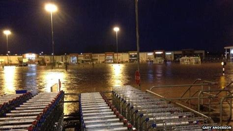inflatable boat asda dozens rescued from flooded asda store in kilmarnock bbc