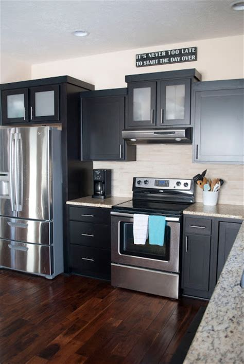 dark kitchen cabinets with dark hardwood floors a kitchen tour with contrasting finishes such as dark