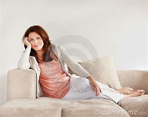 mature couch stock photo happy mature woman relaxing on couch image