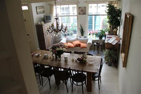 Sitting Area In Dining Room by Dining Room With A Small Sitting Area And A Table Of