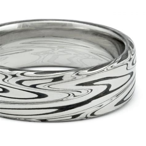 damascus mens wedding band flat with powerful swirling
