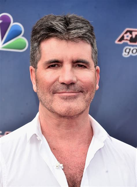 simon s simon cowell gushes about son eric quot he s the world s