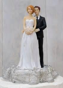 custom wedding cake toppers and groom embroidered silver and groom wedding cake topper