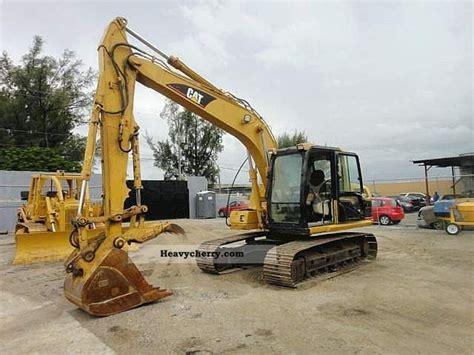 cat cl  combined dredger loader construction equipment photo  specs