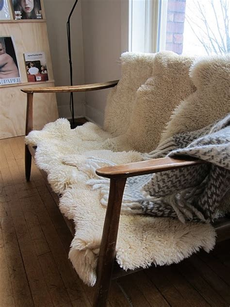 sheepskin rug on sofa top 30 ideas about sheepskin rugs on pinterest posts