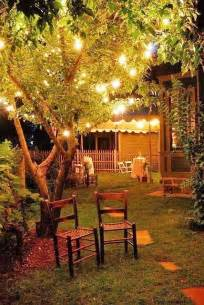 backyard at night with party lights in the trees