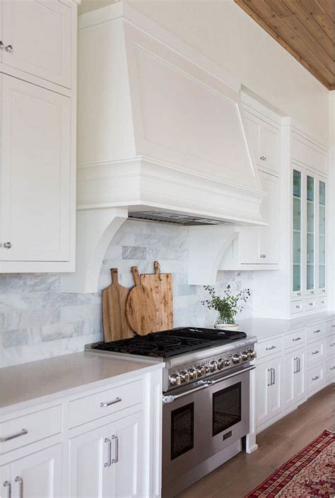 small white kitchen with steel hood 17 best ideas about custom range hood on pinterest