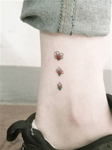 blooming flower tattoo designs 101 tiny ideas for your ink tattooblend