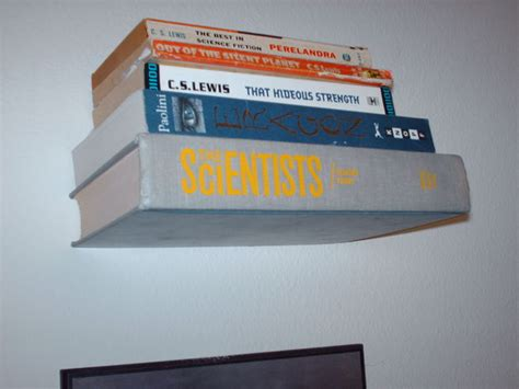 invisible bookshelves made with books
