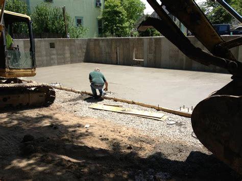 pouring concrete floor of garage athens brick properties llc