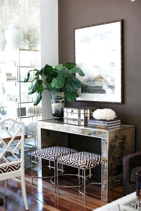 console table with ottomans underneath console table with stools underneath console table with