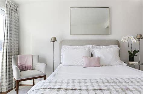 heather gray headboard  white  pink hotel bedding